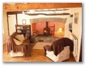 Hollywood Cottage - Holiday Cottages Wales - Living room toward main inglenook fireplace